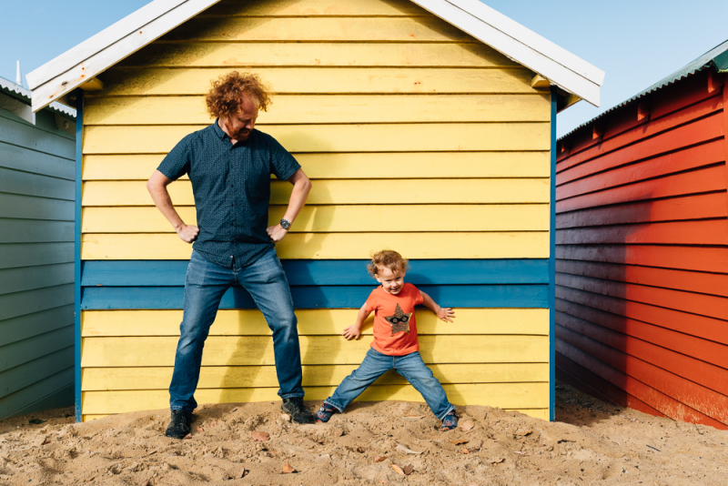 Brighton Beach bathing boxes father and son