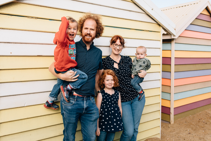 Family in from of Brighton bathing boxes, And So I Don't Forget Photography