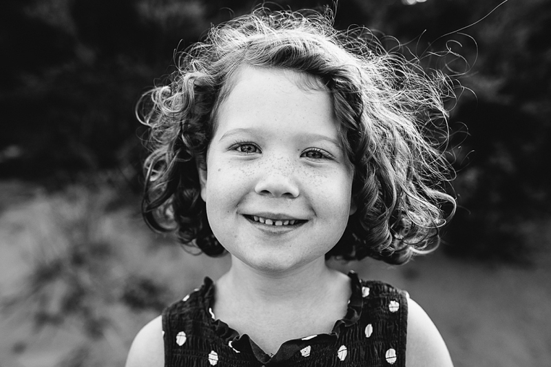 black and white image of young girl with curls and freckles, And So I Don't Forget Photography